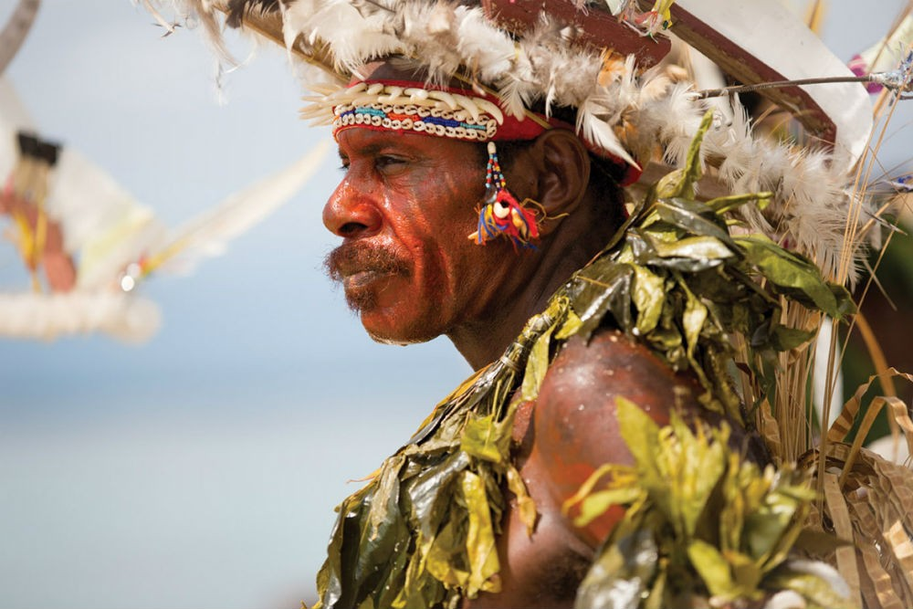 a local man in traditional dress in Papua New Guinea