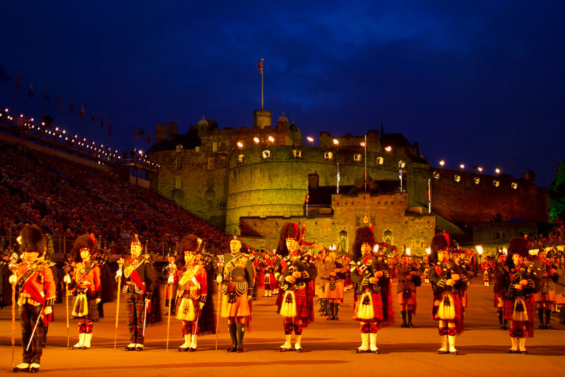 Piper bands on parade in the Castle's torch-lit esplanade during the Edinburgh Military Tattoo