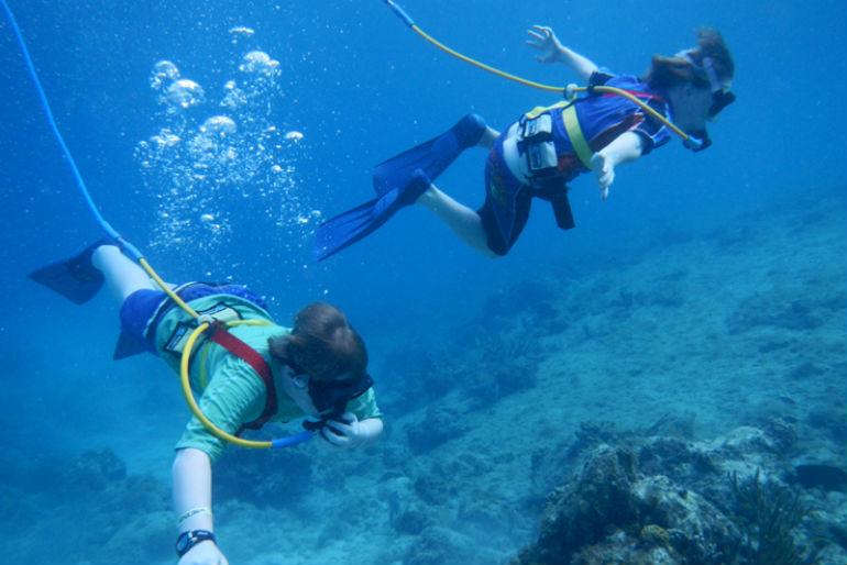 kids snuba diving underwater