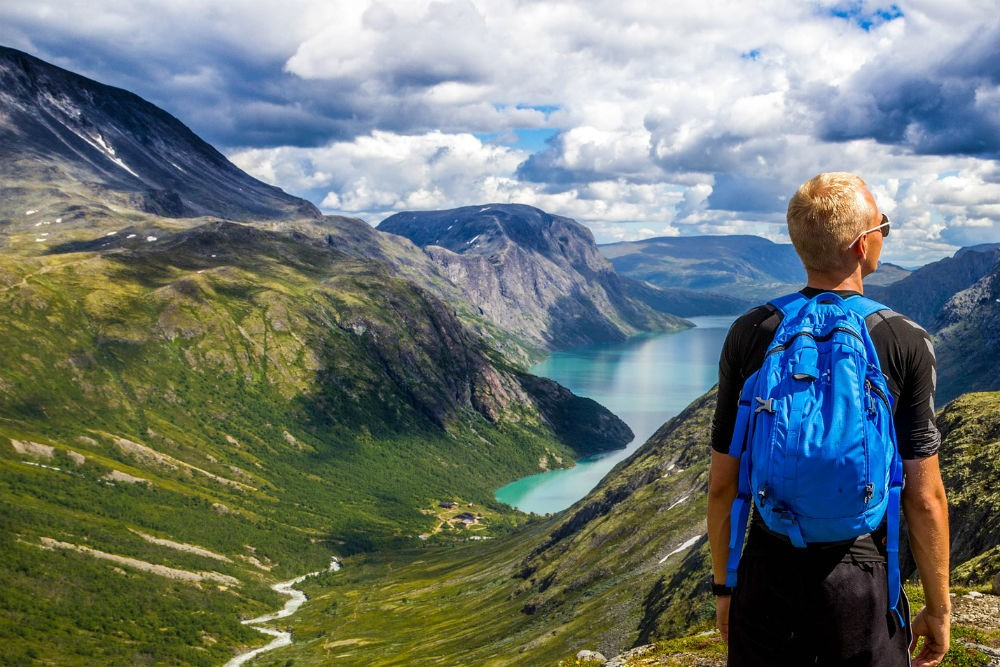 person standing on a mountain in Norway