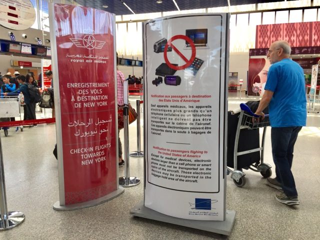 Signage about the electronics ban at the Air Maroc check-in desk