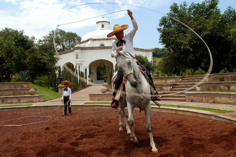 a charro rodeos with a horse in Mexico's Charreria Festival guadalajara Mexico