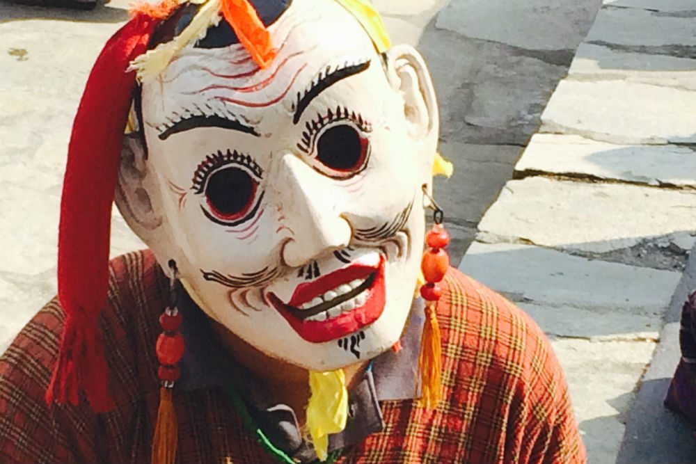 person in mask at Bhutan's annual Gomphu Kora Festival