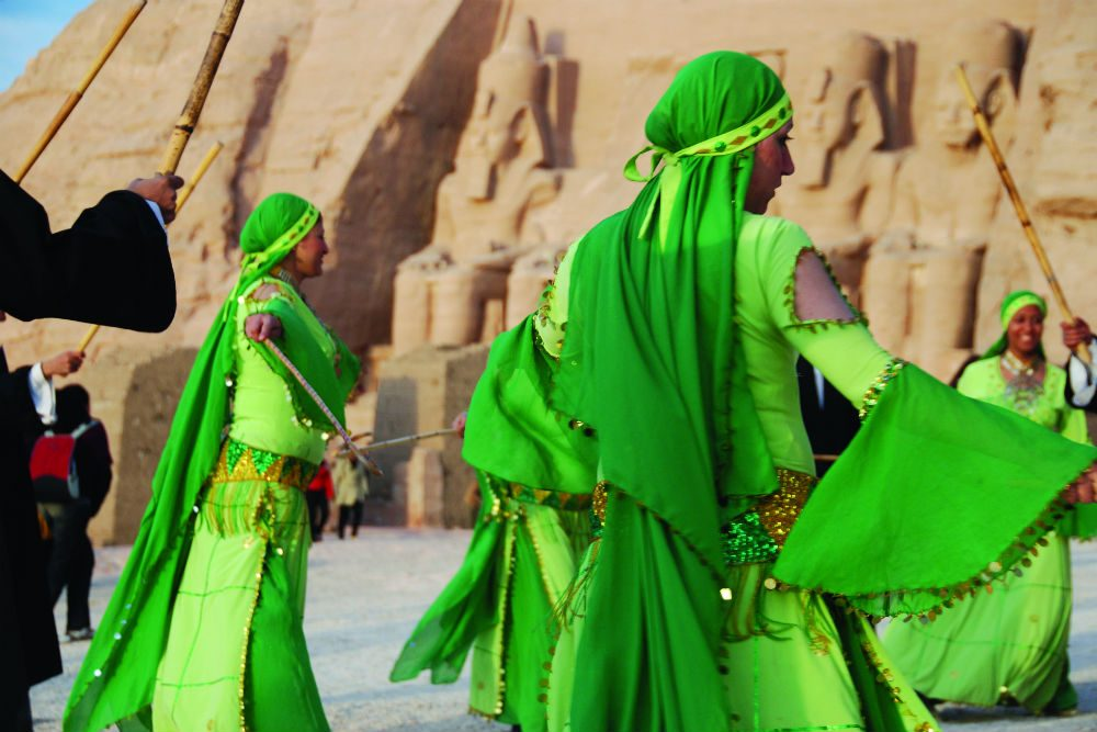 women in green dresses dancing in Egypt