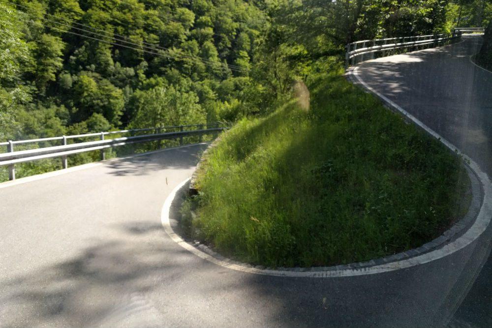 Hairpin turn on road in Ticino Switzerland