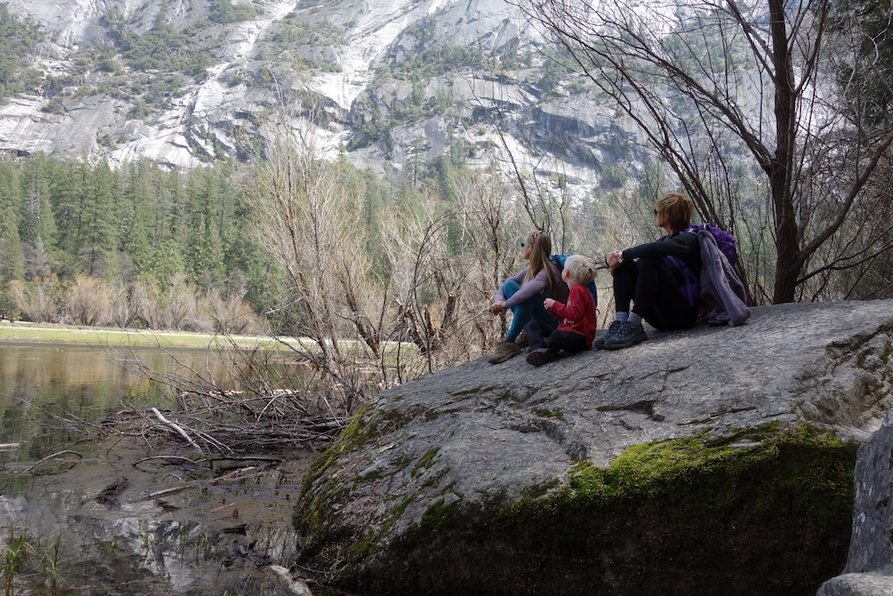 family resting at Mirror Lake in Yosemite national park