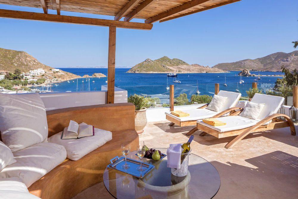 Petra Hotel and Suites terrace overlooking ocean in Greece