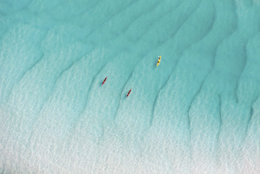 Kayaking at Whitehaven Beach, Whitsundays Islands Australia