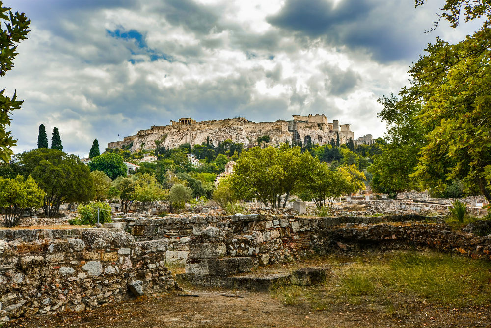 view of the acropolis from afar, with green tree. Athens greece