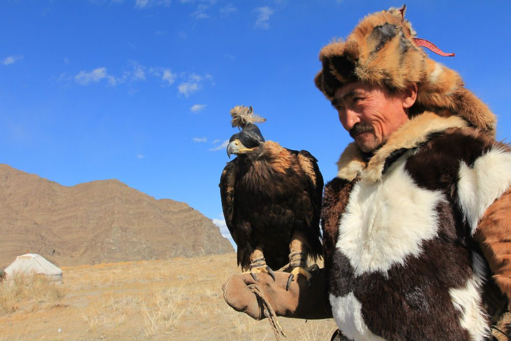 Man with eagle at the Golden Eagle Festival Mongolia