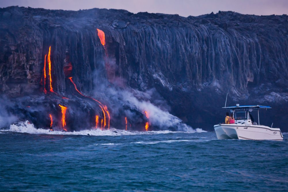 boat at shore dripping with lava, big island, hawaii