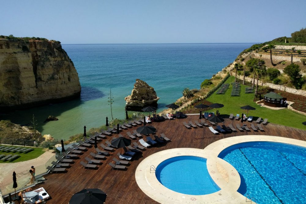View of the pool and sea from the bar deck at the Tivoli Carvoeiro Algarve Resort, Portugal