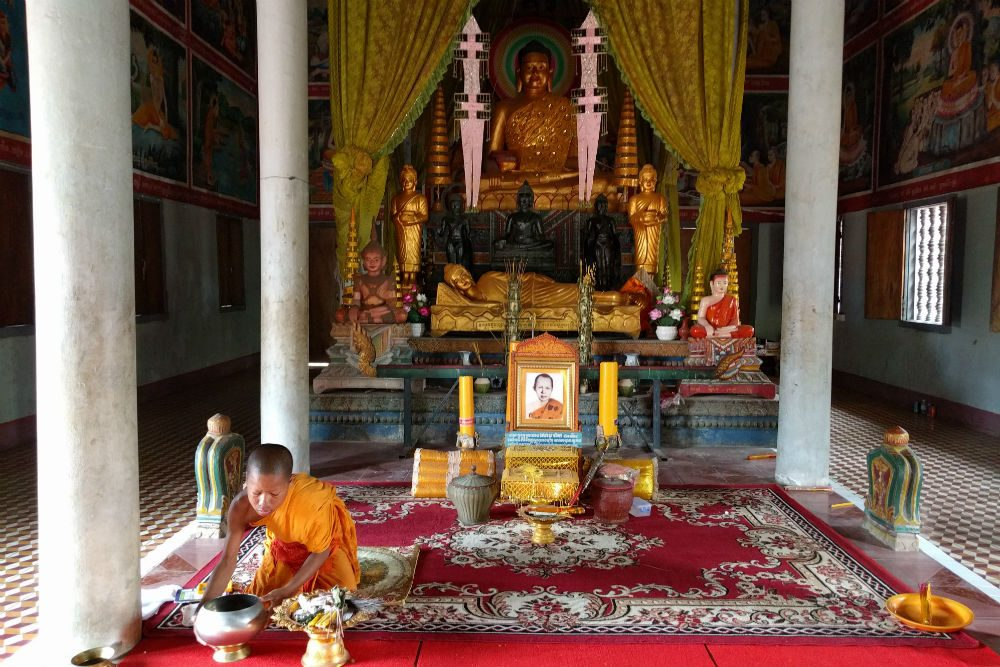 young monk prepares a water blessing at Phnom Krom Pagoda Cambodia