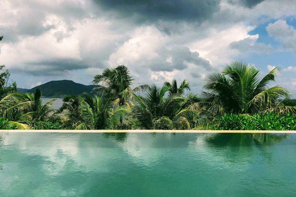 Vietnam infinity pool view over jungle