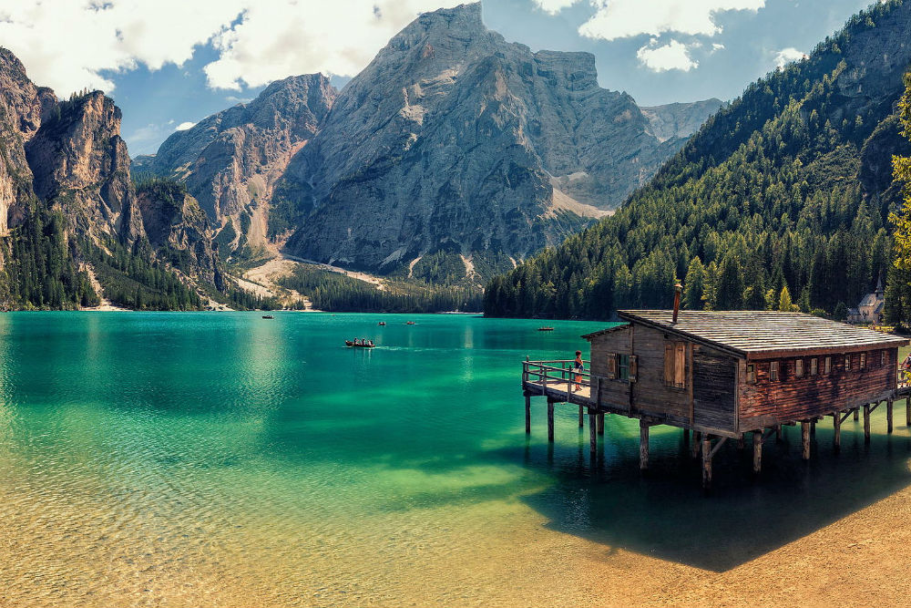 overwater bungalow and mountains at Lago di Braies italy