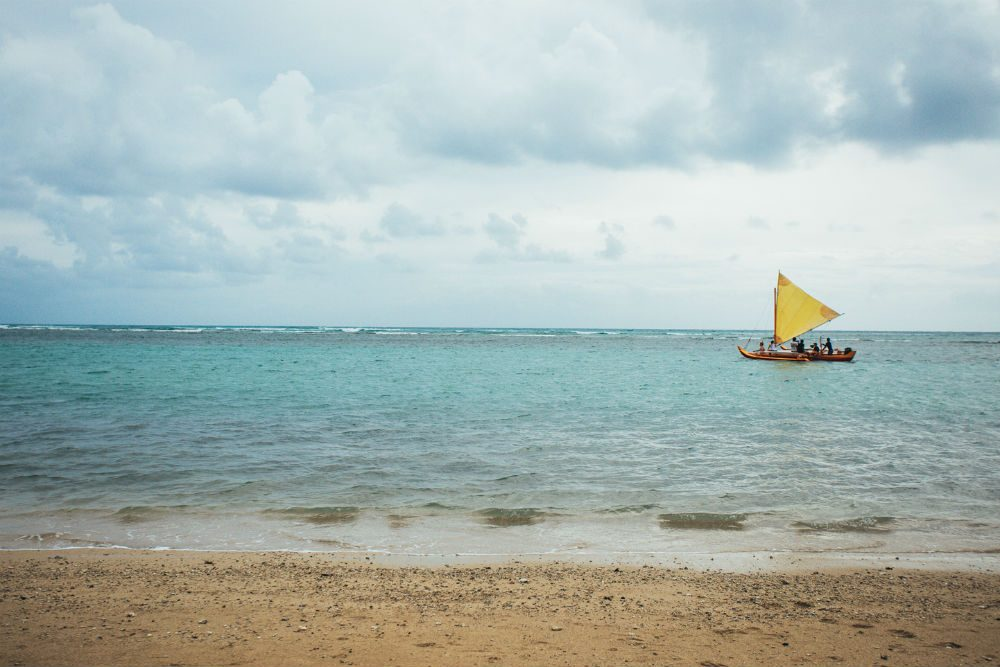 outrigger canoe in the water at Kahala Beach, Oahu