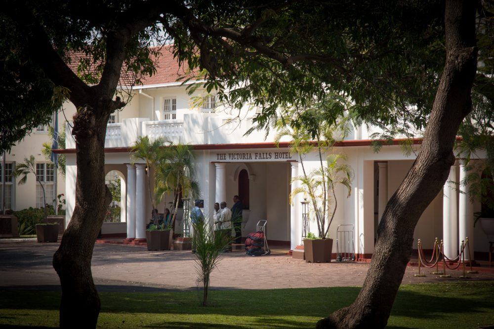 Entering the Victoria Falls Hotel is like walking back in time.