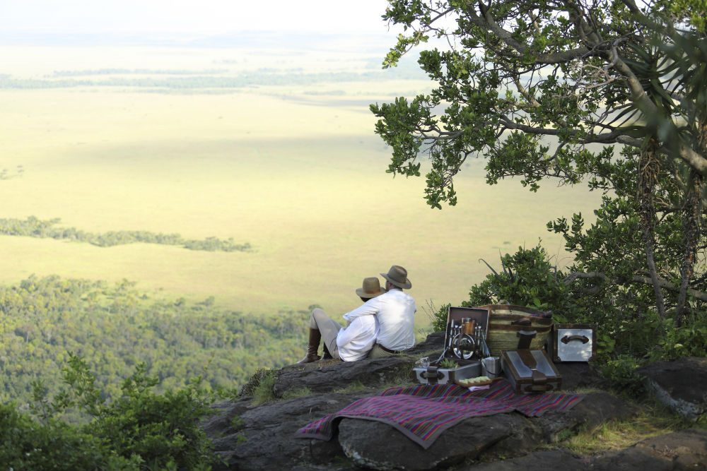 Guests at Angama Mara can have a picnic on a secluded outcropping overlooking the valley
