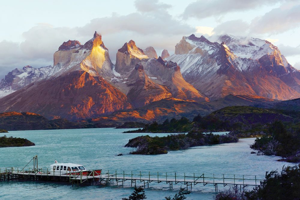 patagonia mountains in front of lake and boat