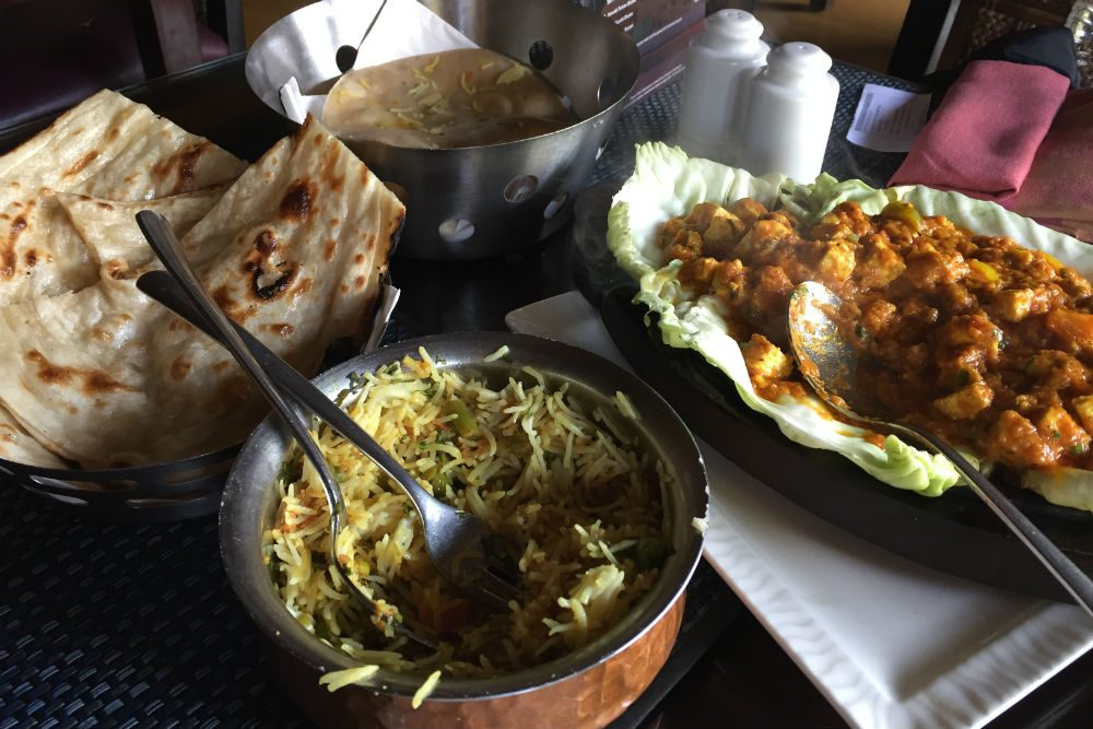 biryani and curry and naan in India