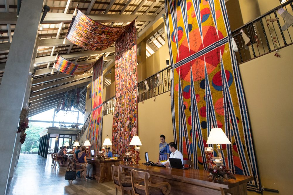 Clue #2: Note the open-air design of the resort's lobby and its batik textiles.