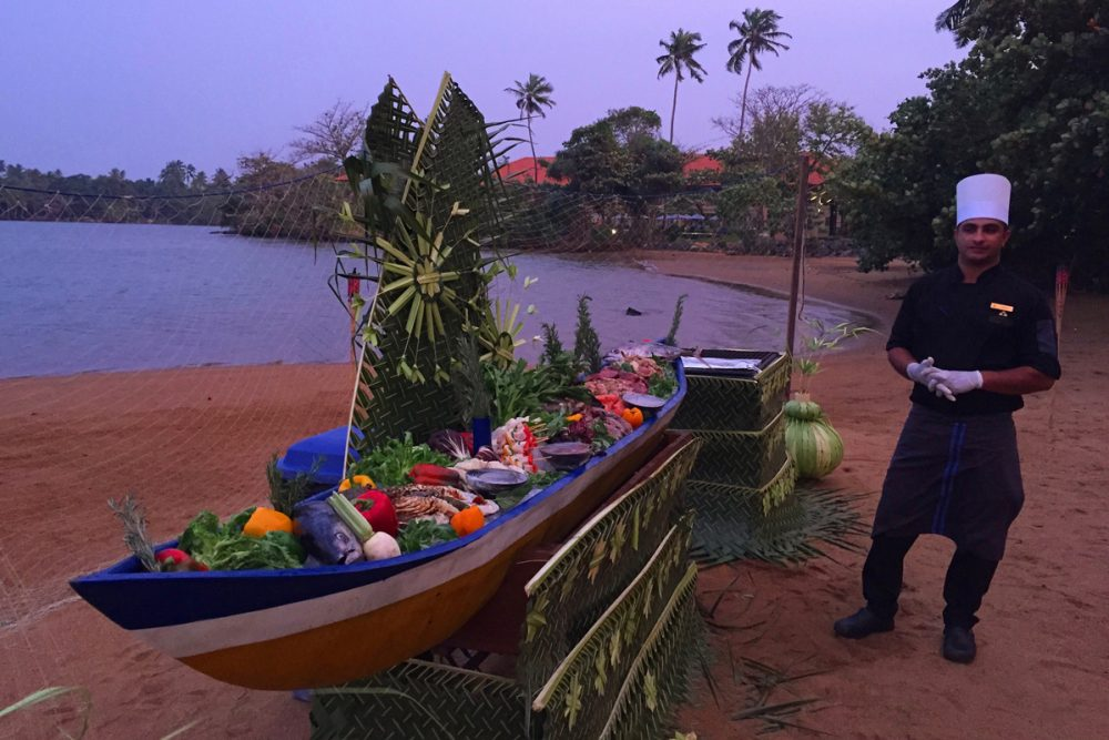 Check out the canoe filled with fresh-caught seafood to be grilled.