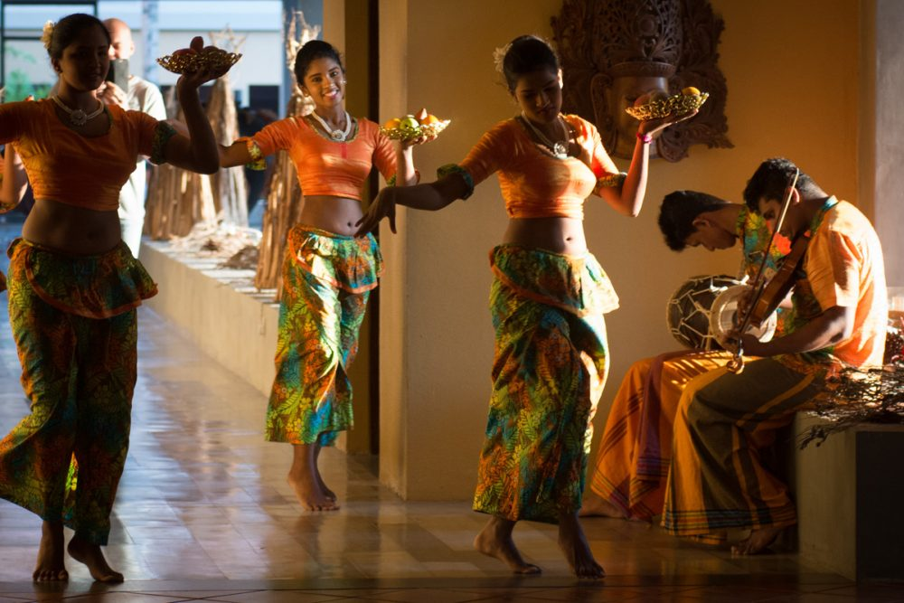 Clue #3: When guests arrive, they're welcomed with a dance. (For the music and movement, see the first video below.)