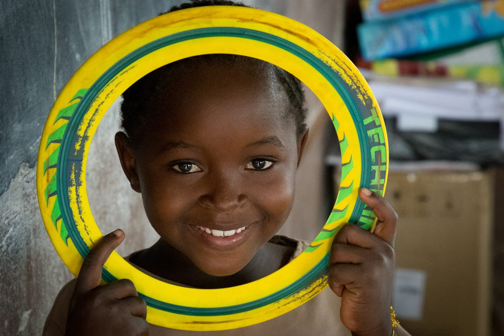 Zambia Chiawa girl with Frisbee ring