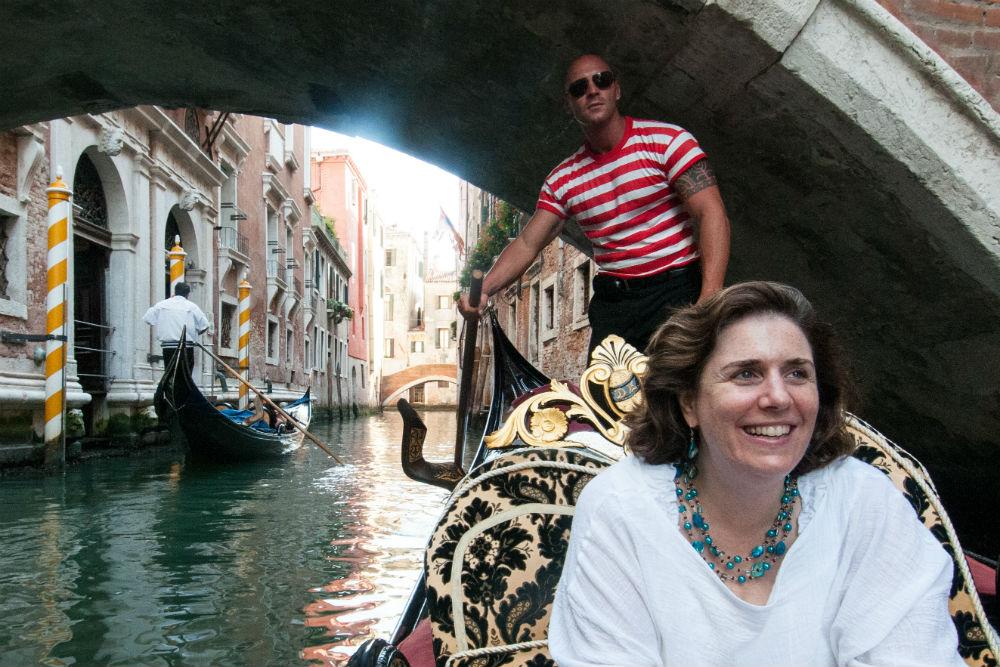 woman in gondola in venice