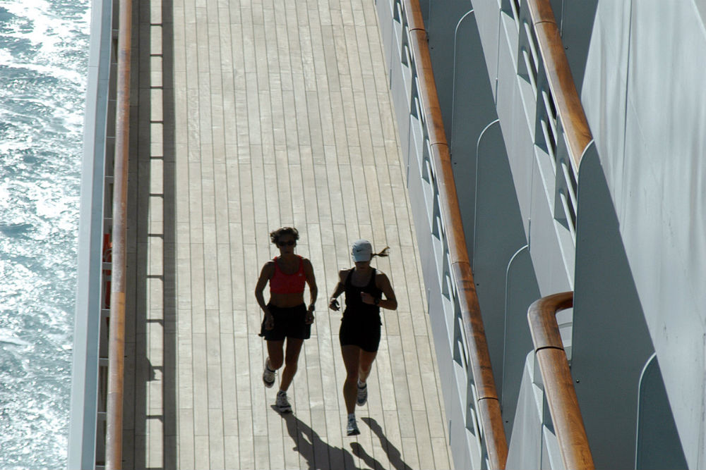 joggers on promenade of crystal serenity cruise ship