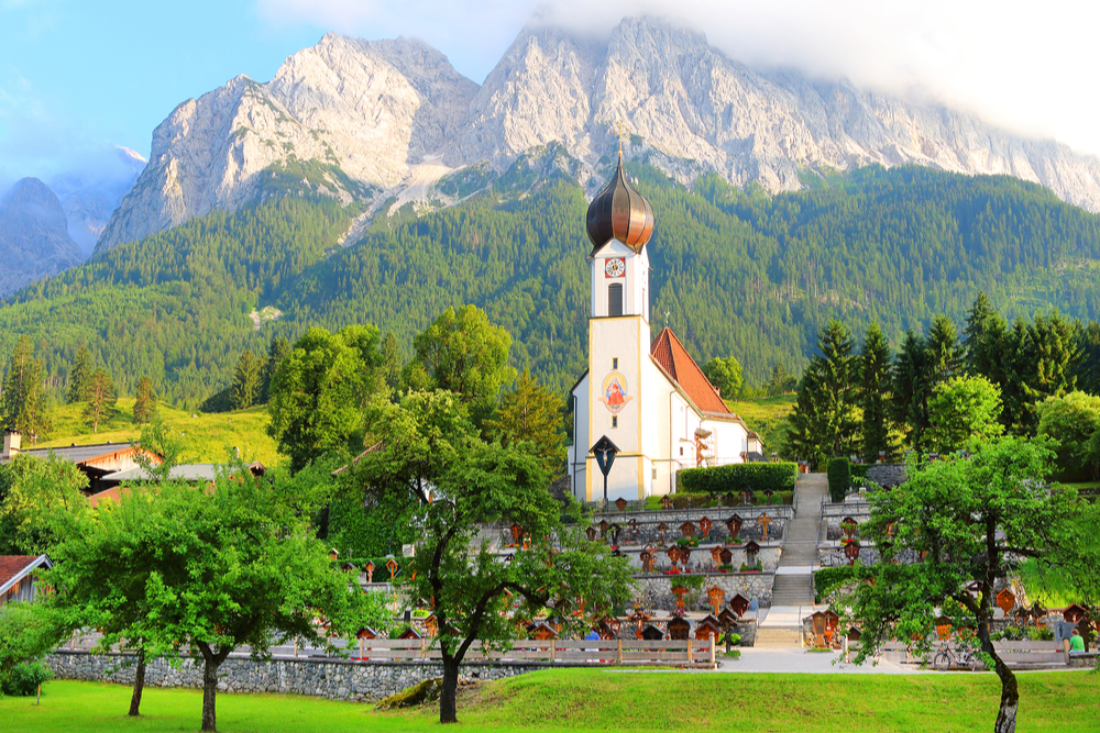 View of Grainau's church with the Zugspitze behind. It is Germany's highest peak