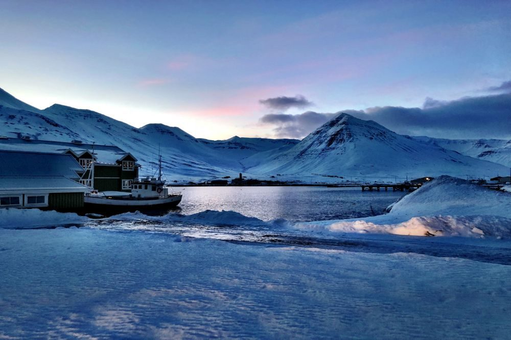 Iceland snowy scene with boat and water CR GreenSpot Travel