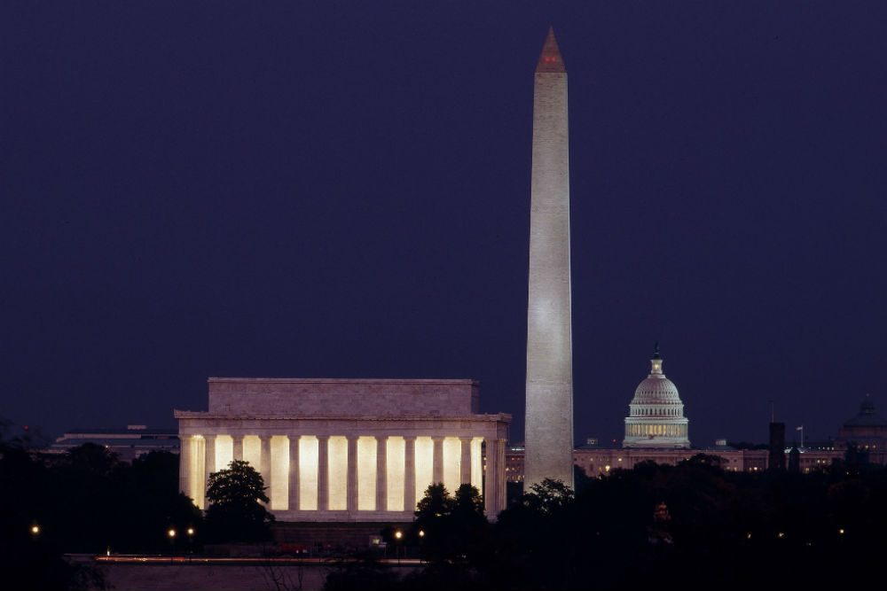 night skyline of Washington DC with Lincoln Memorial Washington Monument and Capitol building