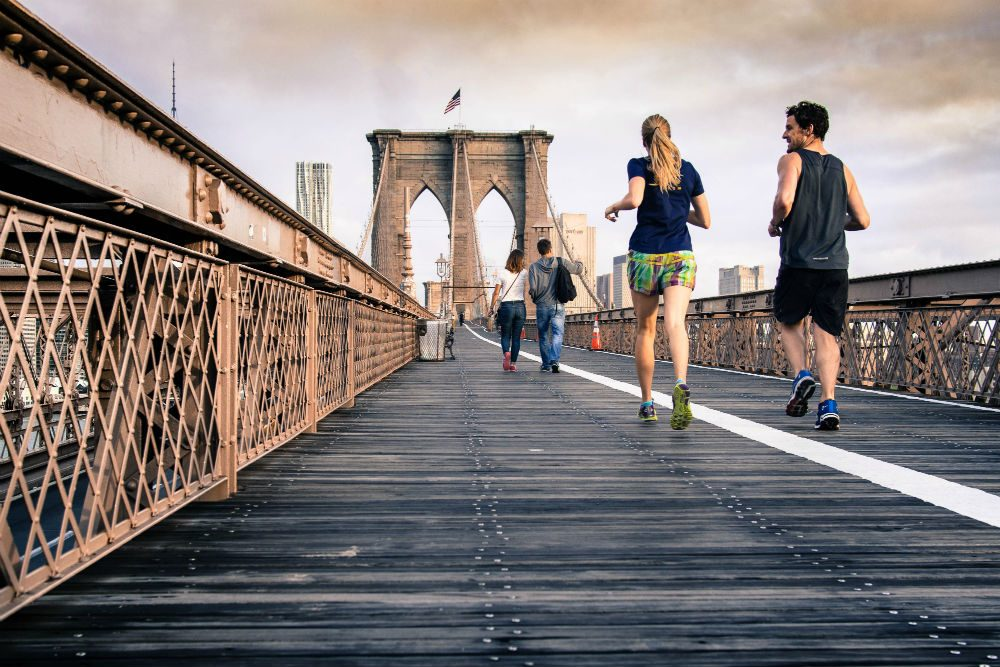 joggers on Brooklyn Bridge New York