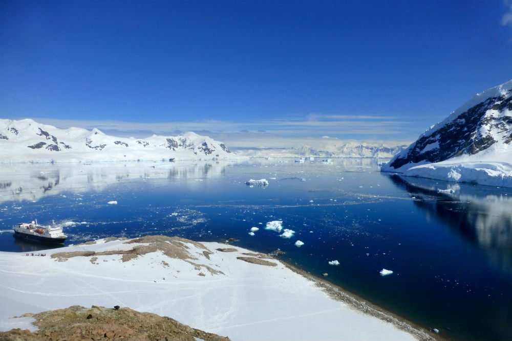 National Geographic Explorer ship in Neko Harbor, Antarctic. Photo: Aabby Suplizio