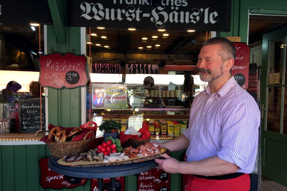 Sausage vendor, Viktualienmarkt Munich Bavaria, Germany. Photo: Claudia Schwenger