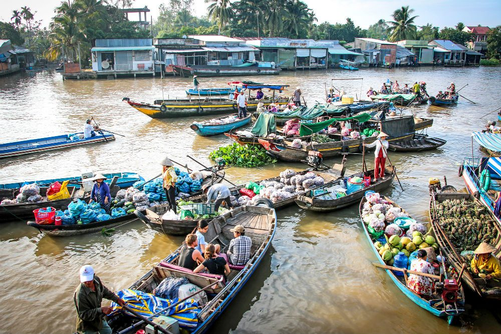 boats with vegetables group together on river for Floating Market in Vietnam