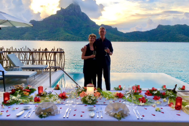 couple on overwater bungalow in bora bora