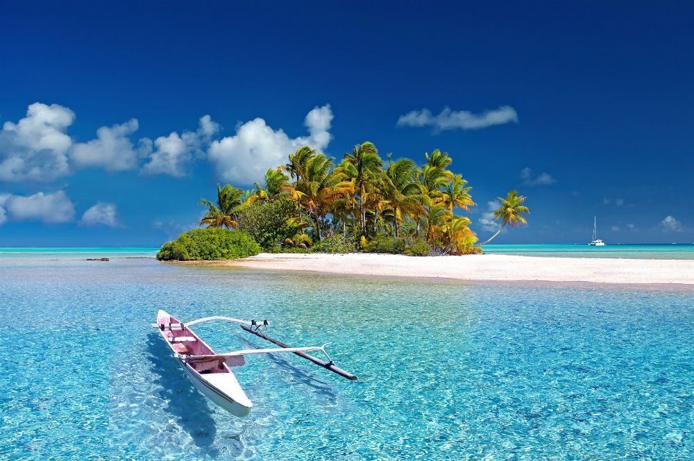 Fakarava island in french polynesia with canoe on turquoise blue water