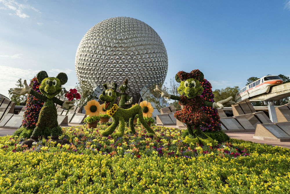 epcot globe with topiary mickey mouse, minnie mouse and goofy at the Epcot International Flower & Garden Festival, Disney World