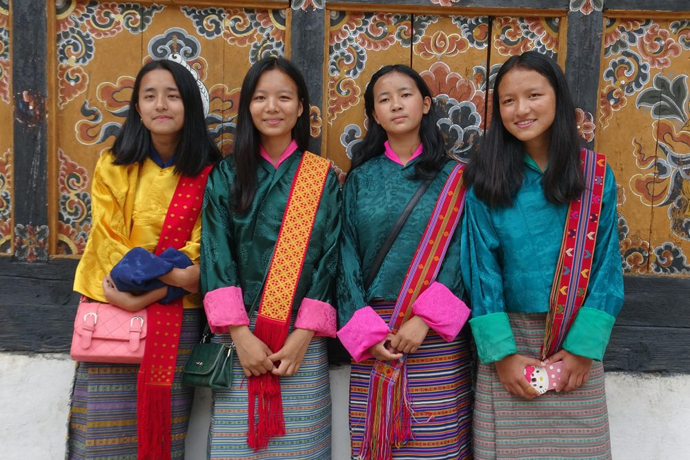 local girls in traditional dress in Thimpu Bhutan
