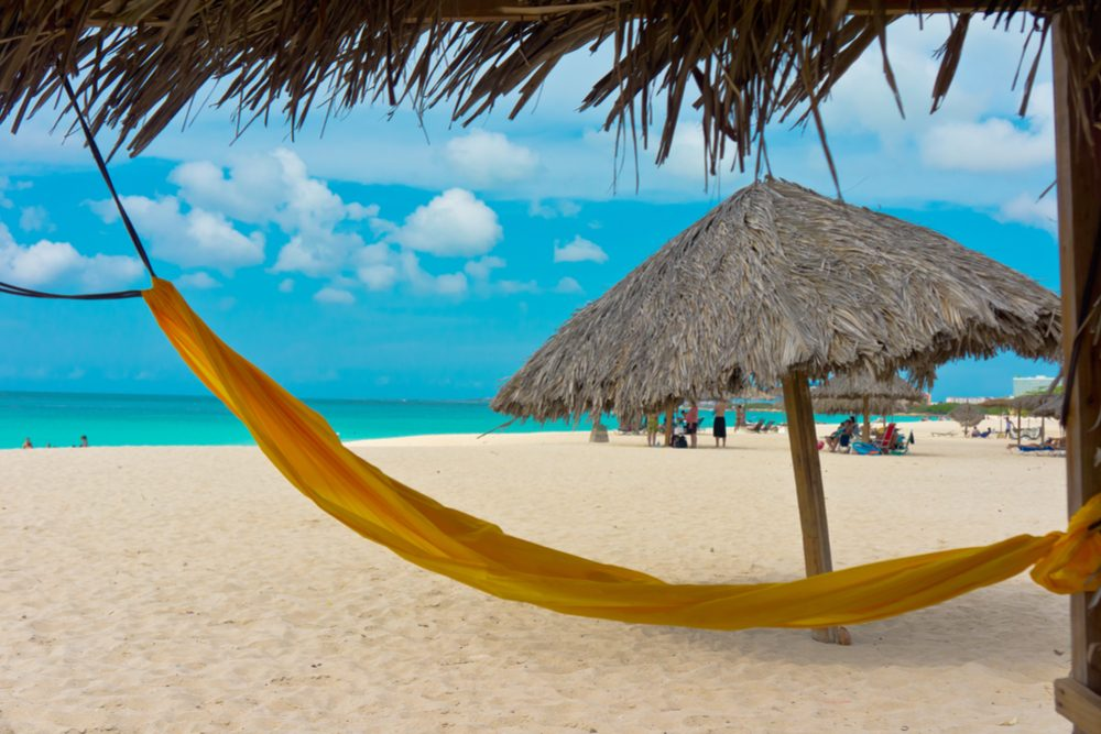 beach with yellow hammock in Aruba, Caribbean Islands, Lesser Antilles