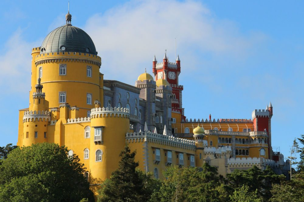 the colorful yellow and red turrets of Pena Palace, Sintra, Portugal