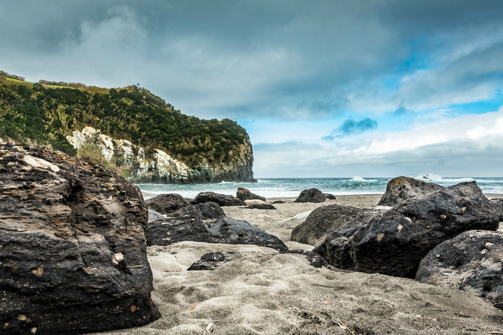 rocky beach and ocean ofPraia dos Moinhos at Porto Formoso on the island of Sao Miguel in the Azores Portugal