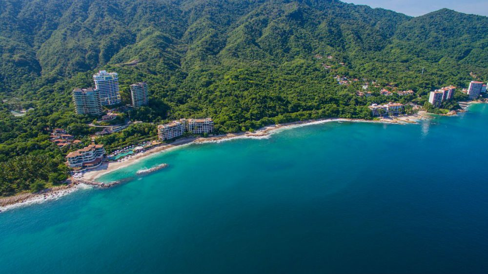 aerial view of green coastline and ocean of Puerto Vallarta Mexico with hotels