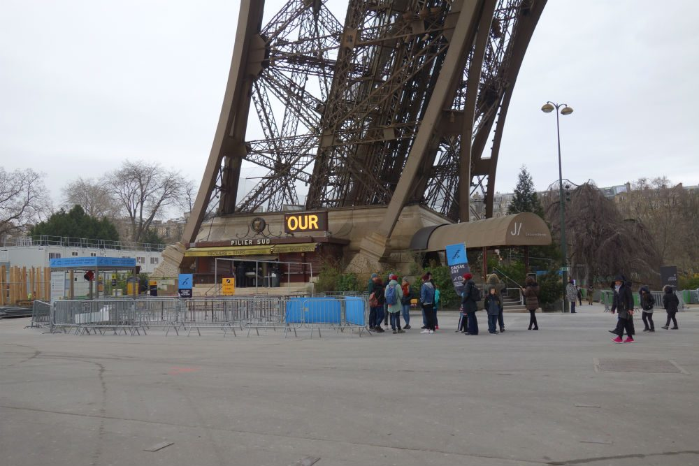 The line for stair-and-elevator tickets up the Eiffel Tower in Paris