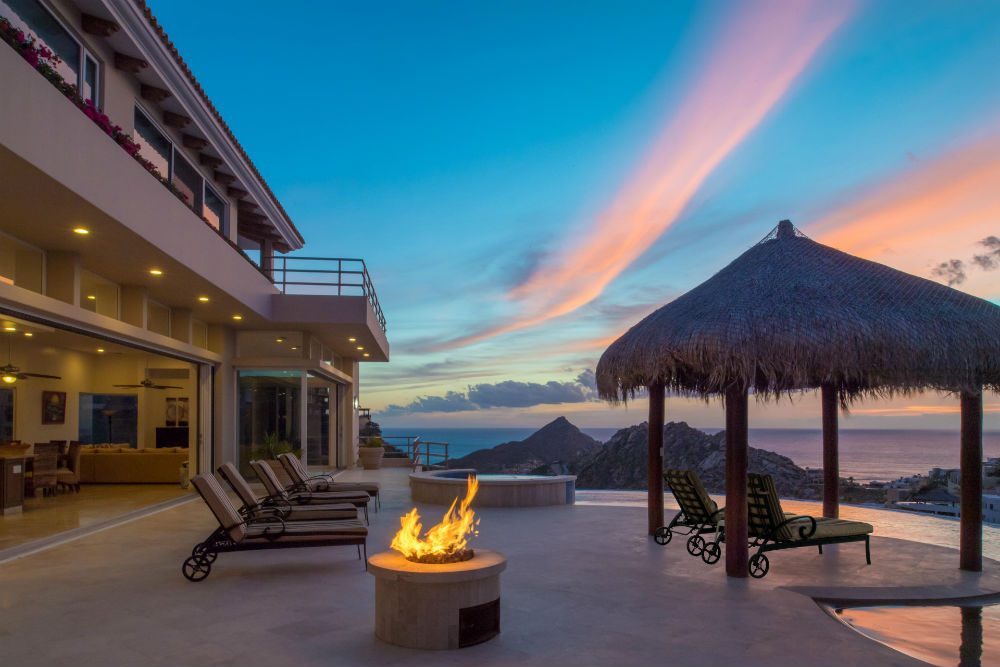 a villa with a firepit and pool in Cabo Mexico