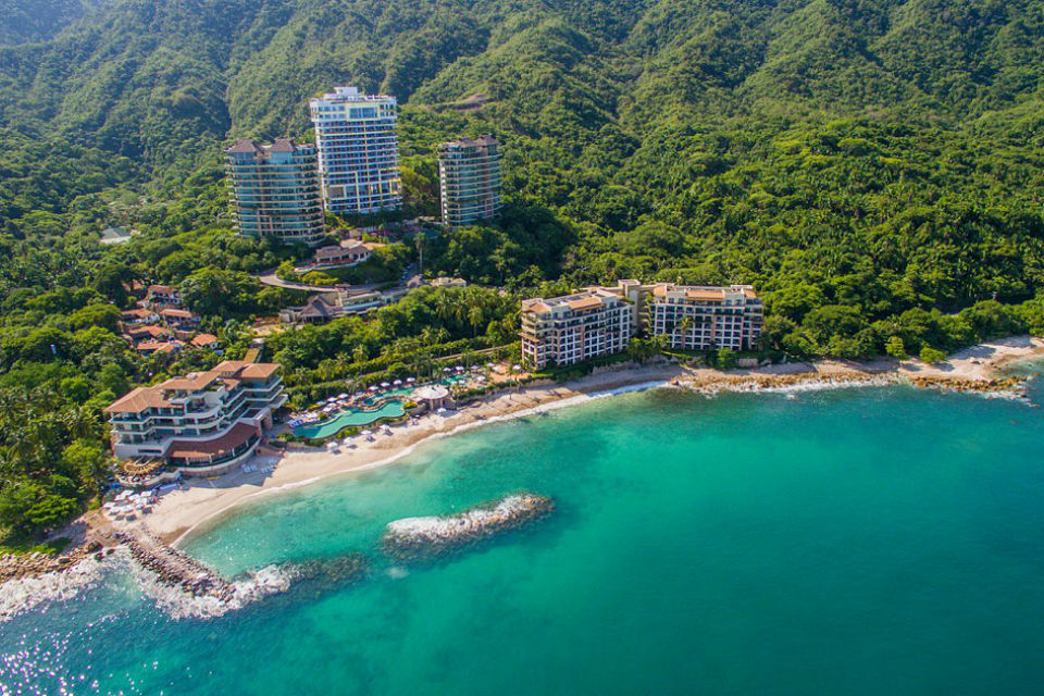 aerial view of Garza Blanca Preserve Resort in Puerto Vallarta Mexico with ocean and jungle mountains