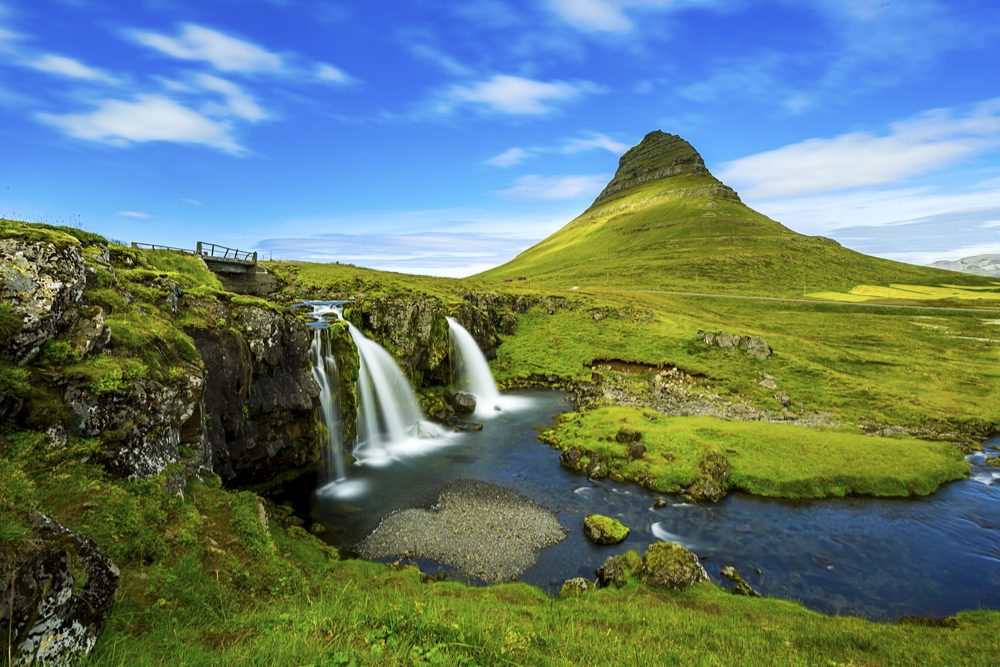 green hills and waterfalls by Kirkjufell mountain,Iceland