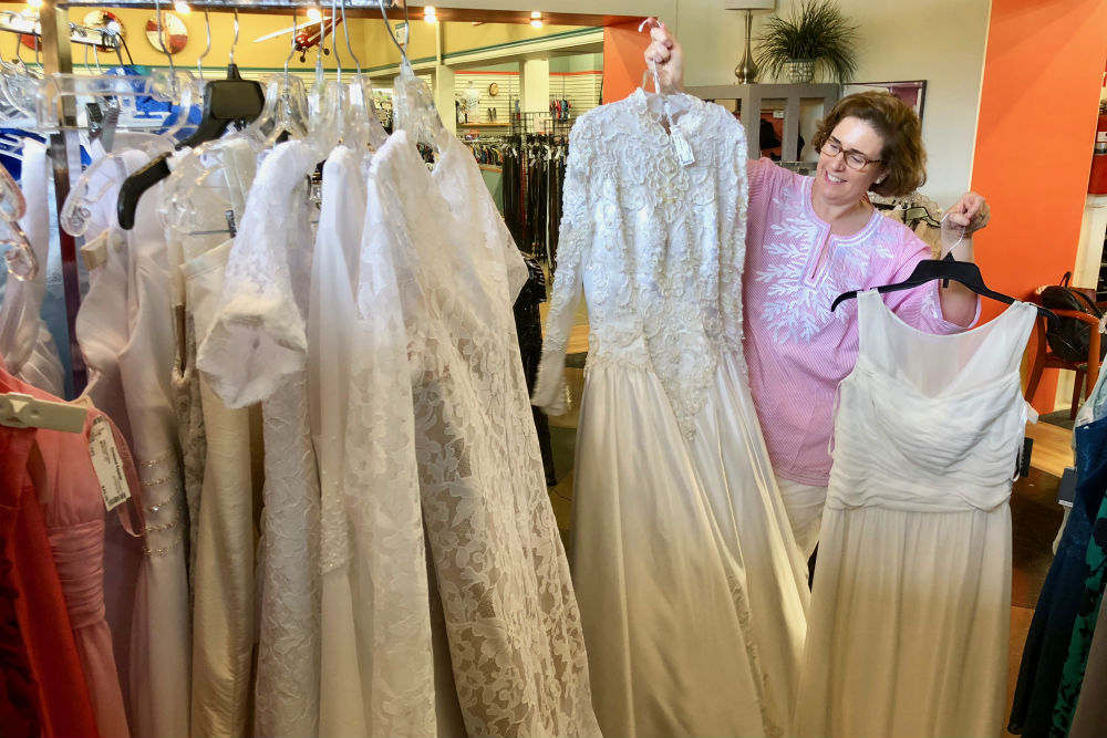 Unclaimed Baggage Center Wendy with wedding gowns